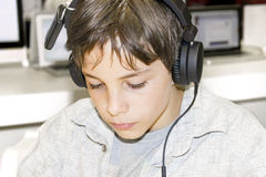 Portrait of a young boy listening to music on headphones. Portrait of a sweet young boy listening to music on headphones Royalty Free Stock Photo