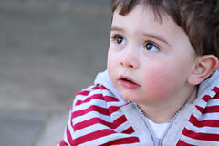 Portrait of a young boy looking upwards Stock Images