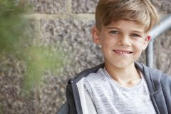 Portrait of a young boy, outside Stock Images