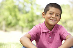 Portrait Of Young Boy In Park Stock Image