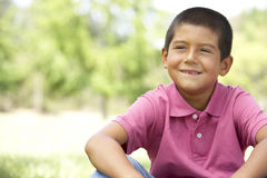 Portrait Of Young Boy In Park Stock Photos