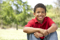 Portrait Of Young Boy In Park Royalty Free Stock Photos