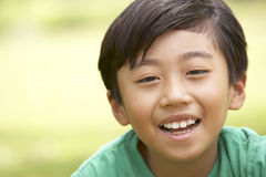 Portrait Of Young Boy In Park Stock Images