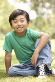 Portrait Of Young Boy In Park Stock Photography