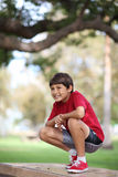 Portrait of young boy in the park Stock Photos