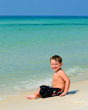 Portrait of young boy playing in surf Royalty Free Stock Photo