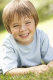 Portrait Of Young Boy Relaxing In Countryside Stock Photography