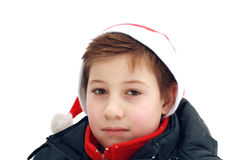 Portrait of a young boy in a Santa hat. Royalty Free Stock Photos