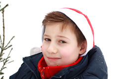 Portrait of a young boy in a Santa hat. Stock Photos