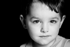 Portrait of young boy with serious expression Royalty Free Stock Photography