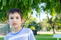Portrait young boy serious thoughtful Royalty Free Stock Image