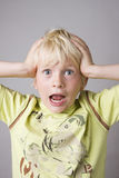 Portrait of a young boy shouting Stock Images