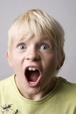 Portrait of a young boy shouting Royalty Free Stock Photos