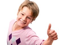Portrait of young boy showing thumbs up Royalty Free Stock Photos