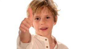 Portrait of young boy showing thumbs up Stock Images