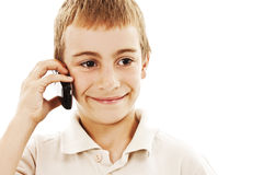 Portrait of a young boy speaking on cellphone Stock Photography