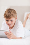 Portrait of a young boy using a tablet computer Royalty Free Stock Image