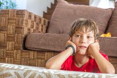 Portrait of young boy watching tv at home. Indoor portrait of young boy watching tv at home Royalty Free Stock Photos