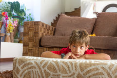 Portrait of young boy watching tv at home Royalty Free Stock Photography