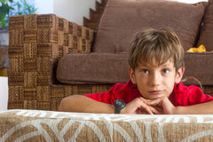 Portrait of young boy watching tv at home Stock Photos