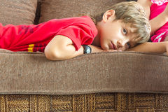 Portrait of young boy watching tv at home Stock Photography