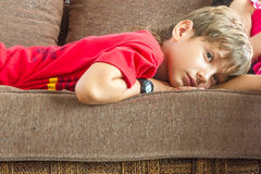 Portrait of young boy watching tv at home Stock Images