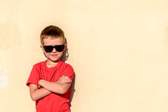 Portrait of young boy wearing sunglasses Stock Photos