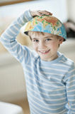 Portrait of young boy with world map as bowl on his head Royalty Free Stock Photography