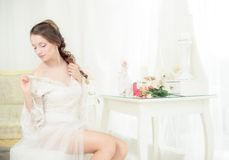 Young bride near the mirror Royalty Free Stock Photo