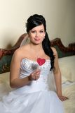 Bride with a red heart in hands Stock Photography