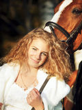 Portrait of young bride with her horse Stock Images