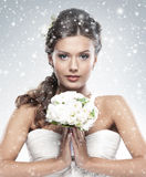 Portrait of a young bride holding white flowers stock photography