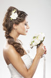 Portrait of a young bride holding white roses Stock Photo