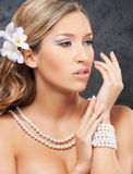 Portrait of a young bride in pearl jewelry Stock Photos