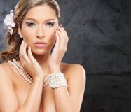 Portrait of a young bride in pearl jewelry Royalty Free Stock Images
