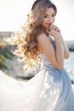 Portrait of a young bride on the shore of the sea Stock Photo