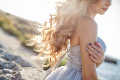Portrait of a young bride on the shore of the sea Royalty Free Stock Photography