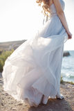 Portrait of a young bride on the shore of the sea Stock Photos