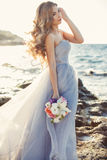 Portrait of a young bride on the shore of the sea Royalty Free Stock Images