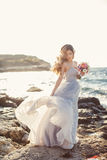 Portrait of a young bride on the shore of the sea Stock Image