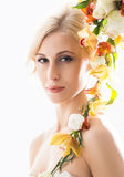 Portrait of a young bride in a white dress posing with flowers Royalty Free Stock Photos