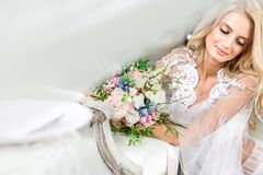 Portrait of a young bride in white lace boudoir stock photos