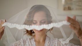 Portrait of young bride with veil. Portrait of young bride in white lace dress with veil stock video footage