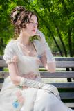 Portrait of woman in bride dress with a book in their hands. Stock Image