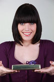 Portrait of a young brown-haired woman with gift Royalty Free Stock Image