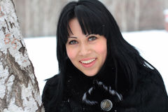 Portrait of a young brunette. In the winter forest Stock Images