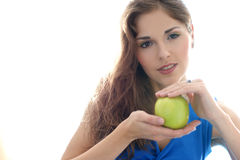 Portrait of a young brunette with an apple Stock Photos