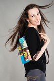 Attractive brunette with a bag Stock Photo