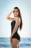 Portrait of young brunette in black swimsuit Royalty Free Stock Images