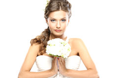 Portrait of a young brunette bride holding flowers Stock Images